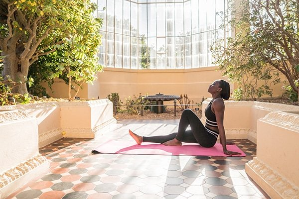 black woman resting after doing yoga